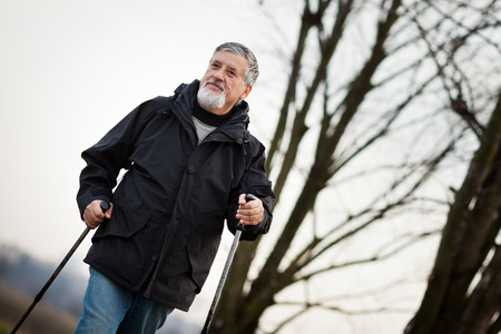 necessary: Senior man nordic walking, enjoying the outdoors, the fresh air, getting the necessary exercise Stock Photo