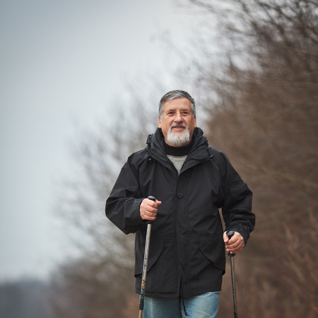 Senior man nordic walking, enjoying the outdoors, the fresh air, getting the necessary exercise Stock Photo - 25817553