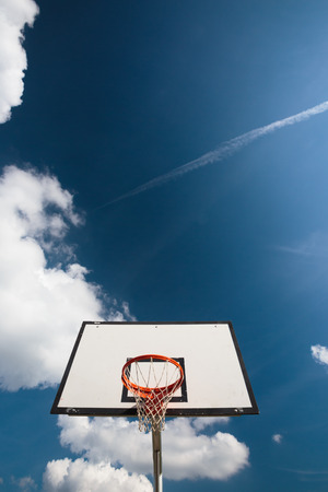 nba: Basketball hoop against  lovely blue summer sky with some fluffy white clouds