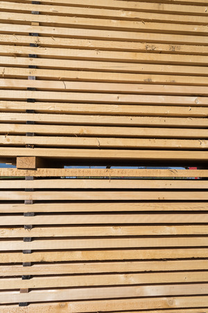 lumber industry: Stack of new wooden studs at the lumber yard