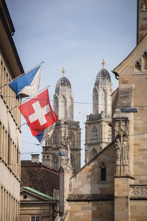 grossmunster cathedral: Zurich, Switzerland - The Grossmunster towers behind Fraumünster church, shot from Paradeplatz Stock Photo