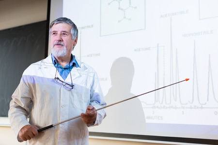 lecturing: Senior chemistry professor giving a lecture in front of classroom full of students