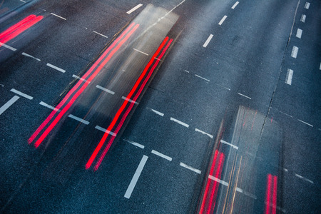 blurred lights: Motion blurred city road traffic (color toned  image)