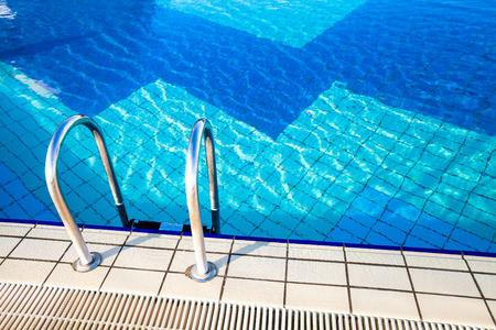 refraction of light: Blue water in a swimming pool Stock Photo