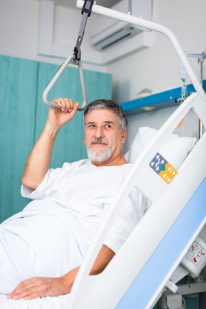 lie down: doctor or nurse talking to patient in hospital Stock Photo