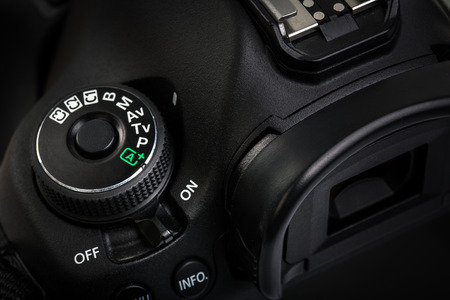 dslr camera: Professional modern DSLR camera - detail of the top LCD with settings - shutter speer, aperture, ISO, AF mode, battery info, RAW format indication,...
