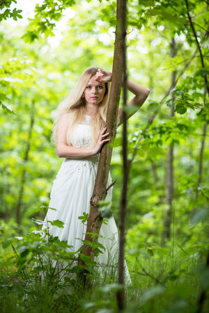 magical forest: Lovely bride outdoors in a forest