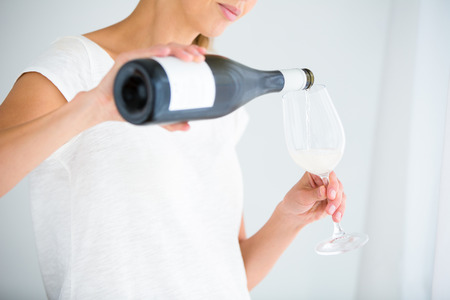 sip: Gorgeous young woman with a glass of wine, smelling the lovely drink, savoring   every sip