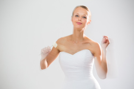 convey: Gorgeous bride dancing, holding a rose (moiton blur technique used to convey the movement)