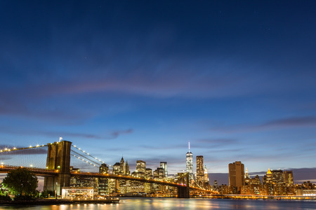 city center: Brooklyn Bridge at dusk viewed from the Brooklyn Bridge Park in New York City