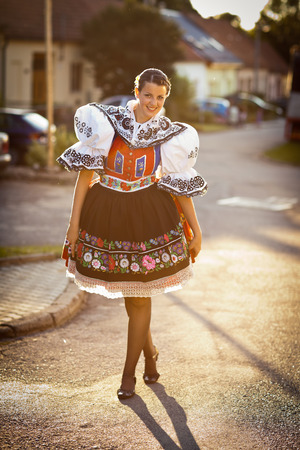 czech women: Keeping tradition alive: young woman in a richly decorated ceremonial folk dressregional costume  Stock Photo