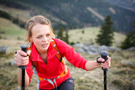 perspiration: Pretty, young female hiker having a tough walk uphill