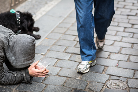the merciful: Begger on the stree Stock Photo