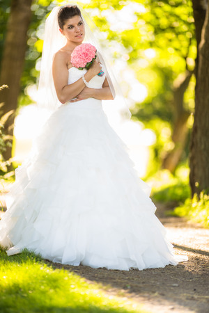 tierra: Gorgeous bride on her wedding day (color toned image; shallow DOF)