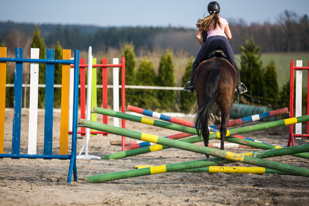 horse show: Young woman show jumping with horse Stock Photo