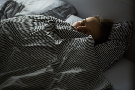 bed sheets: Beautiful young woman sleeping in bed