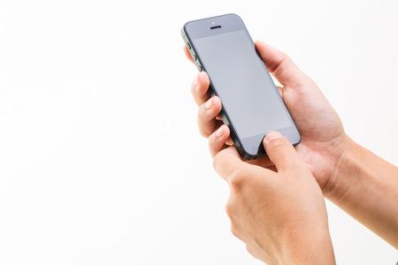 phone isolated: Female hand holding a smart phone, isolated on white Stock Photo