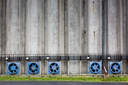 vents: Conrete wall of a cereal silo tower with vents Stock Photo