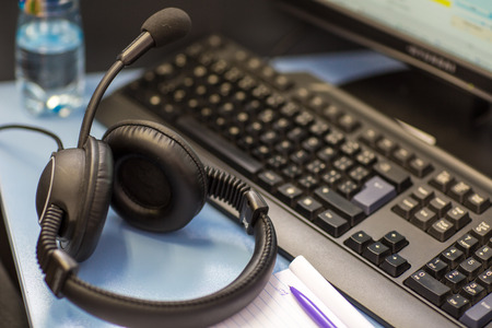 interpreter: interpreting - Microphone and switchboard in an simultaneous interpreter booth (shallow DOF) Stock Photo