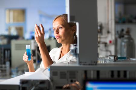 scientific research: Portrait of a female researcher doing research in a lab