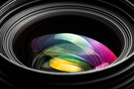 photojournalist: Professional modern DSLR camera llense ow key image - Modern DSLR camera lense with a very wide aperture