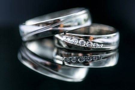divorce: Wedding day details - two lovely golden wedding rings awaiting their moment, with some nice reflections