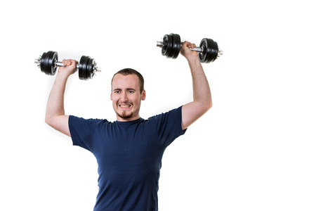 powerful man: Close up of young man lifting weights over white background