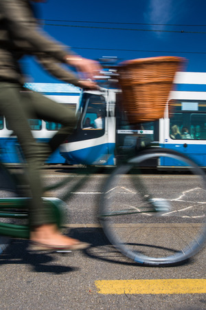 grossmunster cathedral: City transportation concept - commuting methods - on bike, by car, by bus, your choice Stock Photo