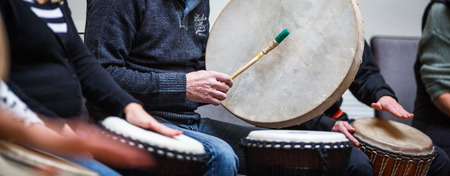 music therapy: Group of people playing on drums - therapy by music Stock Photo