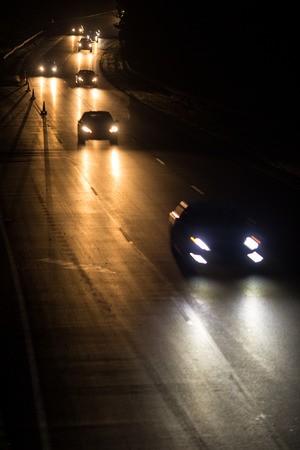 closing time: Busy highway at night with cars of commuters going home from work Stock Photo