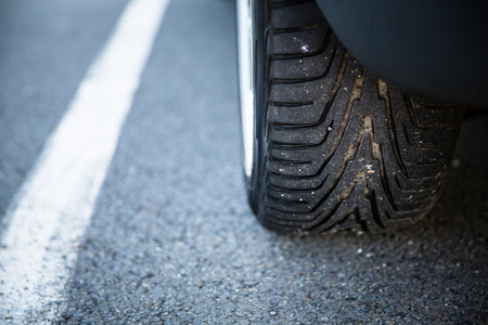 valet: Detail of the tyre of a modern car on road Stock Photo