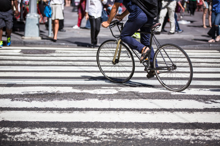 young executive: Man on a bike on a crossing in Manhattan, NYC