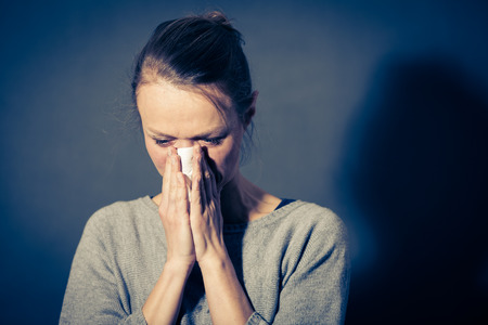 Young woman suffering from severe depressionanxietysadness, crying, tears coming from her eyes Stock Photo