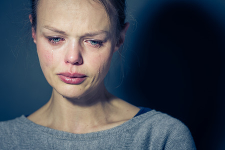headshrinker: Young woman suffering from severe depressionanxietysadness, crying, tears coming from her eyes Stock Photo