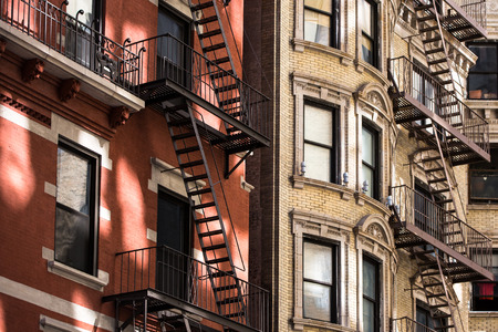 multi family house: Old apartment building with fire escapes, Manhattan, New York City