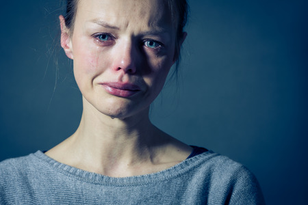 Young woman suffering from severe depression/anxiety/sadness, crying, tears coming from her eyes