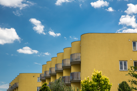 residential building: Residential housing in a city - housing project with plenty of sky as ample copy space