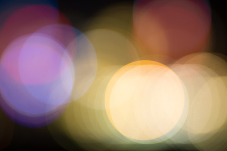 intentionally: Abstract blurry bokeh background - intentionally defocus lights of a city