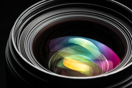 eos: Professional modern DSLR camera llense ow key image - Modern DSLR camera lense with a very wide aperture