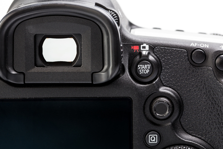 photojournalist: Professional modern DSLR camera - detail of the top LCD with settings - shutter speer, aperture, ISO, AF mode, battery info, RAW format indication,...