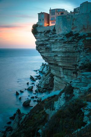 sea cliff: Sunset over the Old Town of Bonifacio, the limestone cliff, South Coast of Corsica Island, France