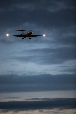 uprise: Passenger Airliner flying in the clouds