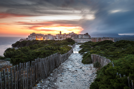Sunset and storm over the Old Town of Bonifacio, the limestone cliff, South Coast of Corsica Island, France Stock Photo