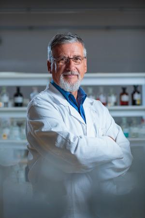 Senior chemistry professor/doctor in a lab (color toned image) 写真素材