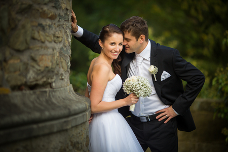 france: Beautiful, happy, younf wedding couple in a splendid historic castle environment, walking up the stairs, shining with happiness