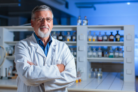 Senior chemistry professor/doctor in a lab (color toned image) Foto de archivo
