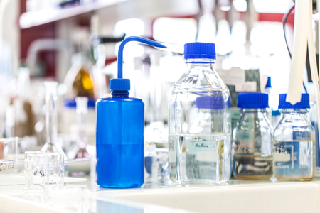 technical assistant: Young female scientist works in modern chemistry  biology lab