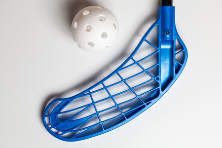 floorball stick and ball on white background