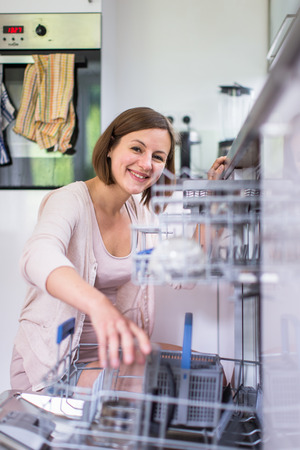 Young woman in her lovely, modern kitchen photo