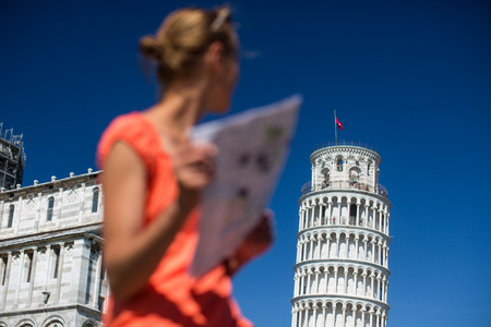 admiring: Gorgeous female tourist with map admiring the Leaning Tower of Pisa, Tuscany, Italy (shallow DOF)